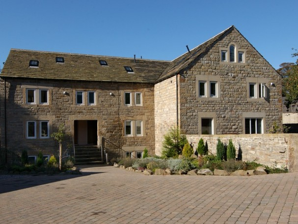Grade II listed former cornmill converted into 4 spacious homes by Eastwood Homes.
