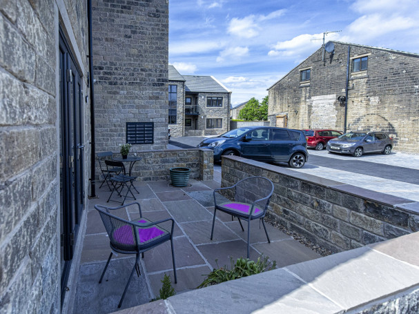 Outdoor private patio at ground floor apartment