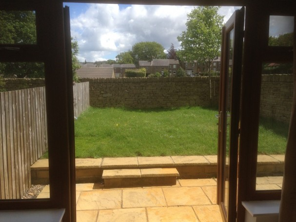 French doors from living room leading into garden.