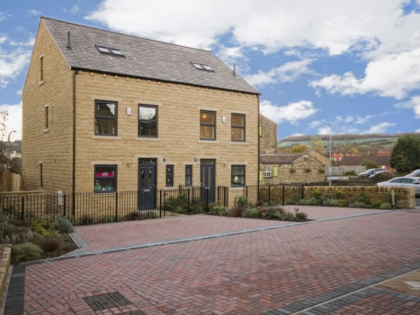 Homes at Bradshaw Gardens have landscaped gardens and parking.